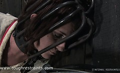 Cici struggles in metal head cage and straitjacket