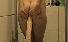 Amatuer brunette fills her ass with a big dildo and piss