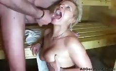 Mature blonde German woman in the sauna blows and gets nailed