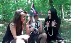 Brunette pissing on lesbos from a tree