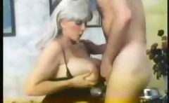 Candy Samples is a vintage boobilicious porn babe who gives a guy a sample