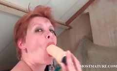 Bitchy MILF masturbates pussy in bed