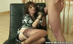 Mrs Sonia gives her subject a hand with his erection