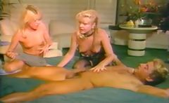 Vintage scenes of classic porn star Nikki Charm sucking and fucking in a threesome 