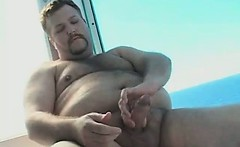 Chubby hairy gay dude gets naked